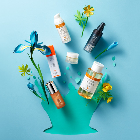 Space Nk advertising campaign with multiple beauty and skincare products shot with flower paper art By Ian Oliver Walsh Still Life Photographer London