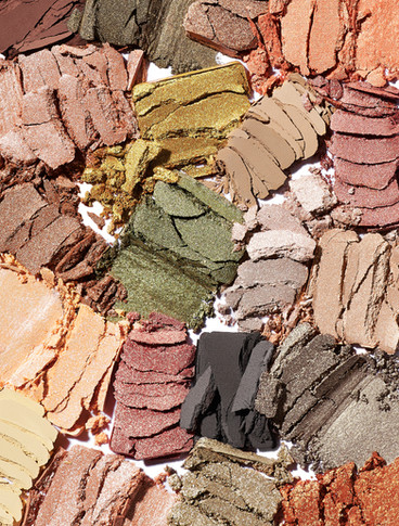 macro texture of mutiple eyeshadow crumbles from a makeup palette By Ian Oliver Walsh Still Life Photographer London