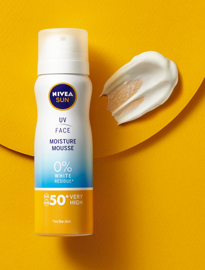Nivea skincare texture enxt to its product packagingon a sunny yellow background for Waitrose By Ian Oliver Walsh Still Life Photographer London