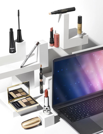 Moving image cinemagraph of makeup products such as lipstick and mascara sat on an abstract composition of white plinths By Ian Oliver Walsh Still Life Photographer London