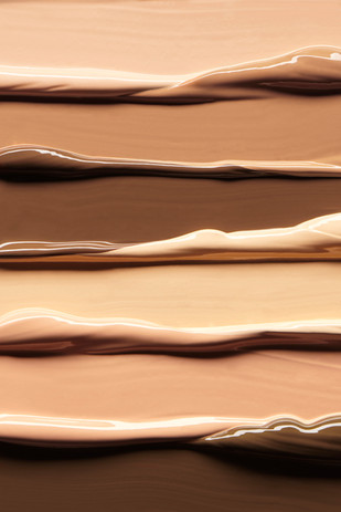 Macro closeup texture of glossy makeup concealers from a beauty products in various skin tones By Ian Oliver Walsh Still Life Photographer London