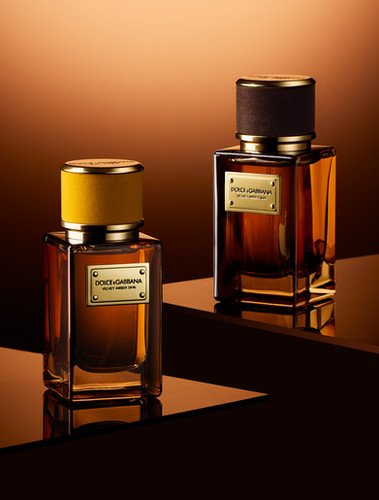 Luxury Dolce Gabanna perfume fragrances shot against a warm amber background By Ian Oliver Walsh Still Life Photographer London