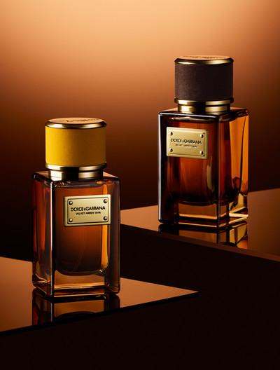 Luxury Dolce Gabanna perfume fragrances shot against a warm amber background By Ian Oliver Walsh Still Life Photographer London
