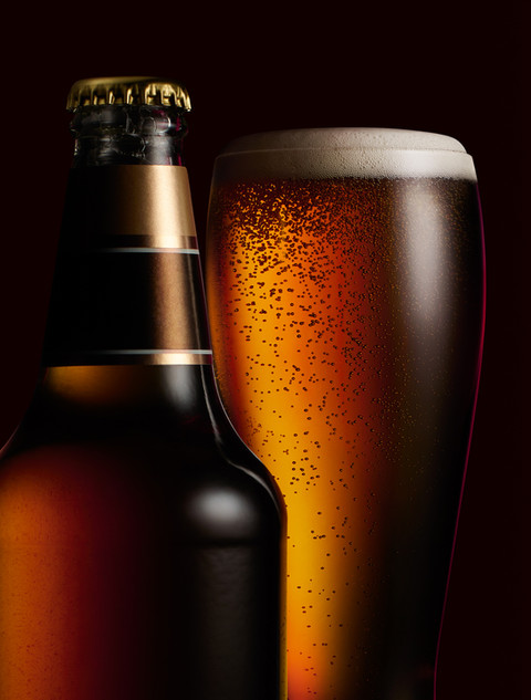larger and beer bottle poured in to a glass for Waitrose drinks advertising campaign By Ian Oliver Walsh Still Life Photographer London