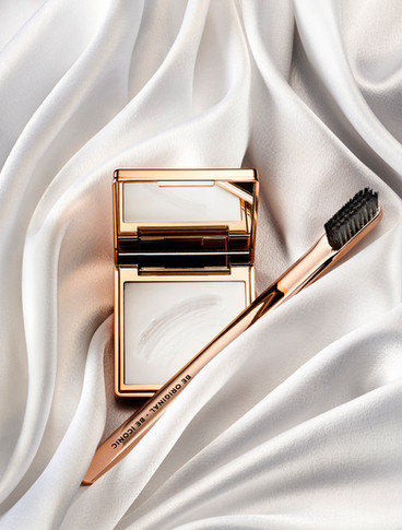 Iconic London beauty brow sat in a texture of luxurious silk swirls and sweeps and advertising image for By Ian Oliver Walsh Still Life Photographer London