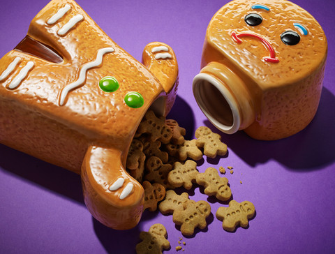 Gingerbread man biscuits spilling out of cookie jar By Ian Oliver Walsh Still Life Photographer London