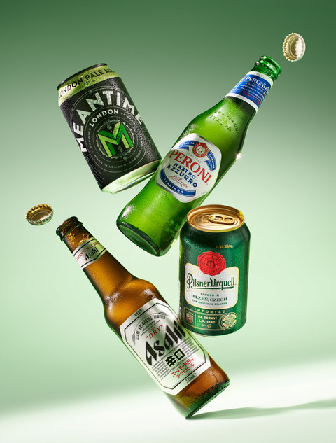 Alcohol drinks and beer such as peroni and Asahi falling in the air for Waitrose magazine By Ian Oliver Walsh Still Life Photographer London