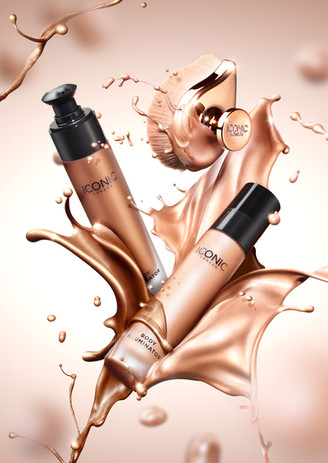 Iconic beauty products with high speed splashing shimmering liquid and droplets by still life photograpehr Ian Oliver Walsh London