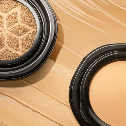 close up macro of AHC foundation makeup palettes the background is gloss smears of product in various skin tones By Ian Oliver Walsh Still Life Photographer London