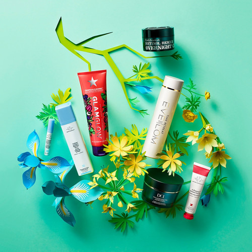 beauty cosmetic skincare products on an arrangement of floral paper art for Space NK advertising By Ian Oliver Walsh Still Life Photographer London