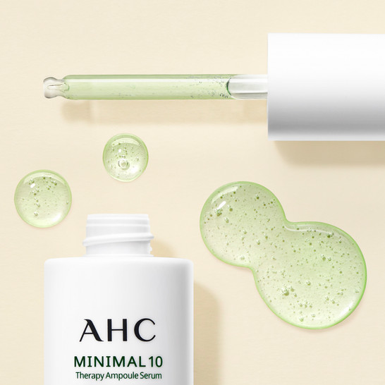 advertising an AHC facial serum texture next to its packaging and pipette By Ian Oliver Walsh Still Life Photographer London