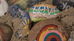 Painted love rocks (Photo by Nick Fewings)