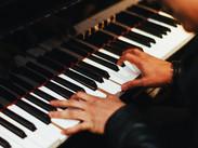 Man playing piano (Photo by Gabriel Gurr