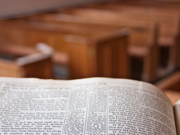 Bible-on-pulpit-with-empty-wooden-pews_7
