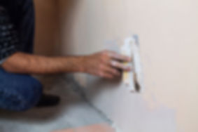 Plasterer working on room.jpg