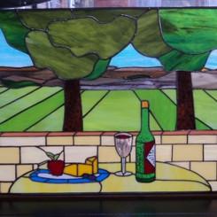 Frans landschap met een goed glas wijn.