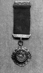 Medal presented to Fred.