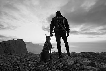 Silhouette of young man with his dog at
