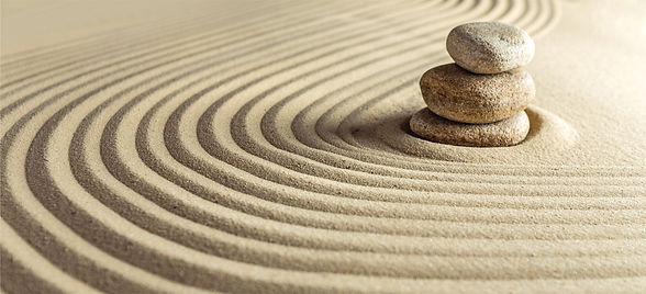 Japanese zen garden with stone in raked
