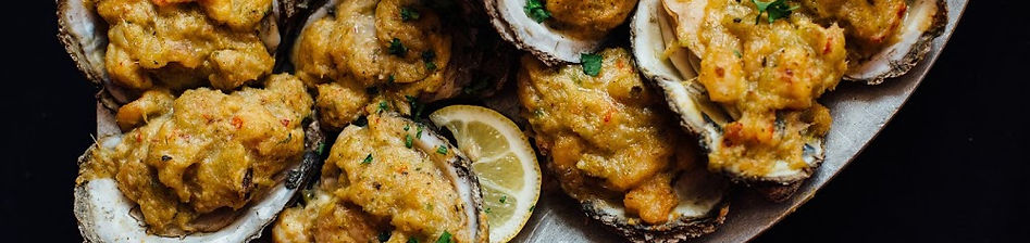Char-grilled oysters from Felix's Restaurant & Oyster Bar in New Orleans, LA