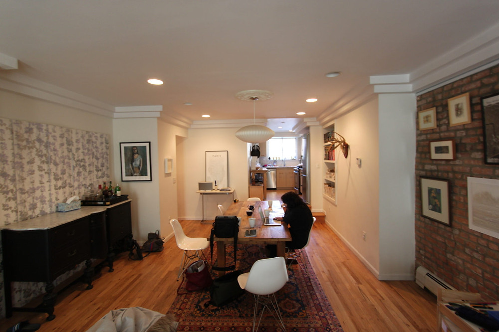 The kitchen and dining area were dark and dated before the renovation, but much of the homeowners' furniture and art remained in the house post-remodel.