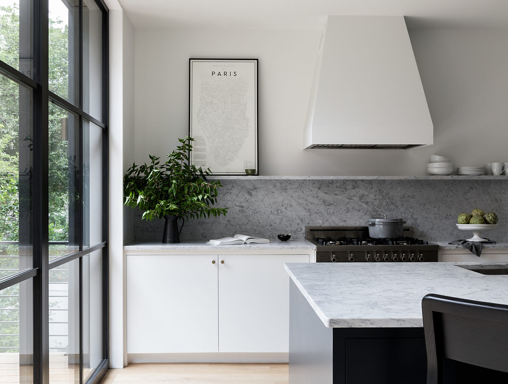 The kitchen range is Bertazzoni and the hood is Faber.