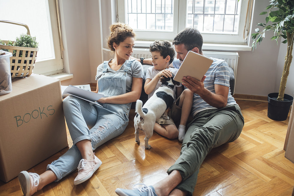 Husband and wife and their son and a pet