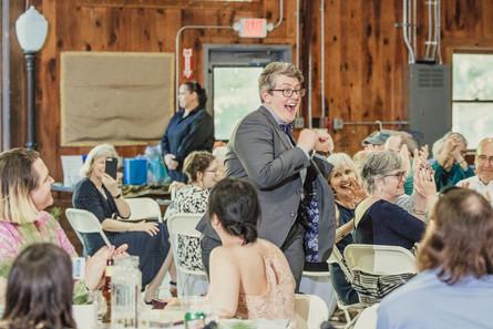 Wedding guest enters the venue, dancing.