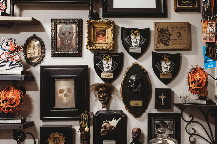 Wall of Gabriel Londis' rewards from tattoo conventions.