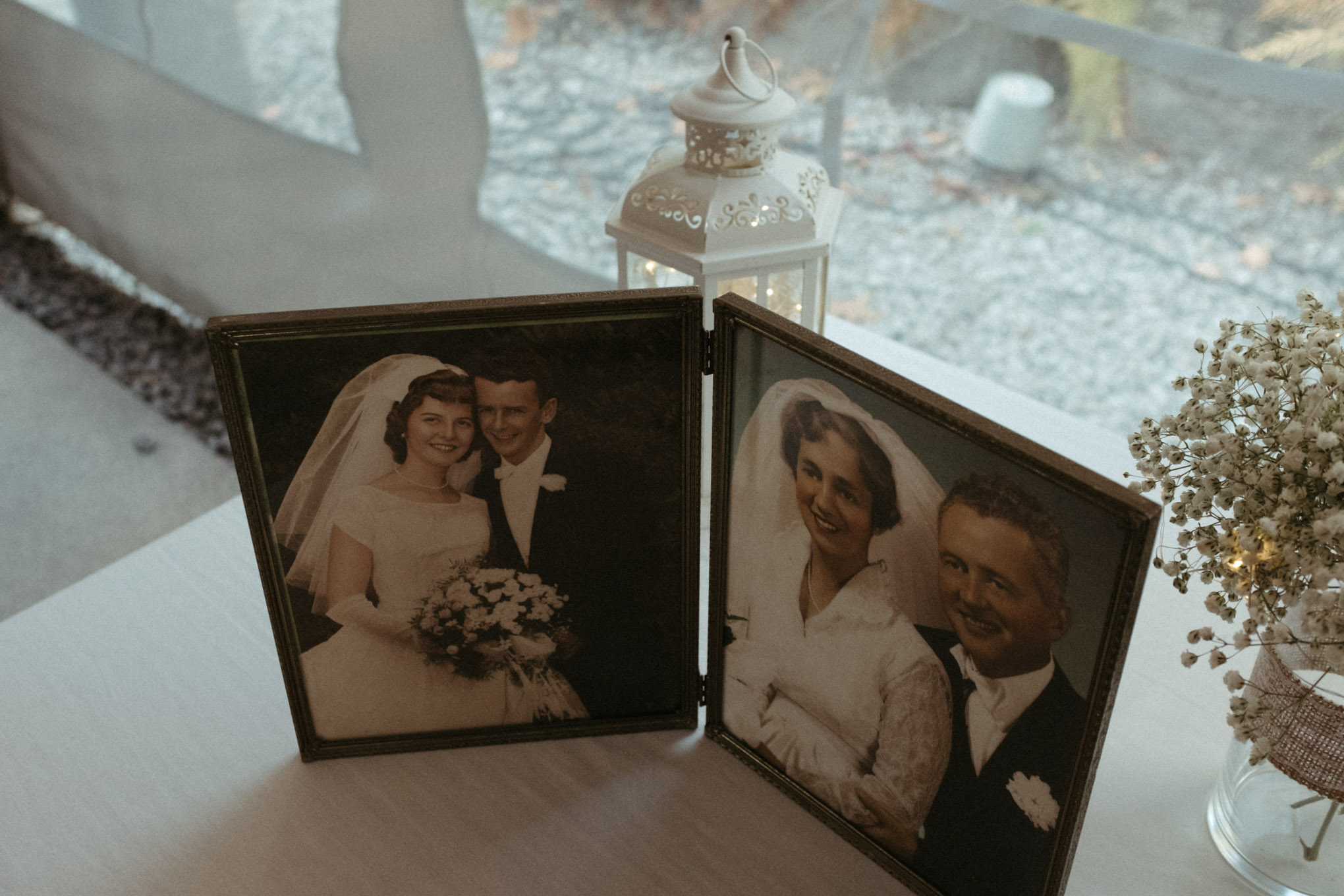A wedding memorial table that show two sets of grandparents on their wedding day. One set are my grandparents, Judy and Bill Hogan, Sr.
