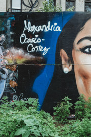 Part of a painted graffiti portrait of Alexandria Ocasio Cortez (AOC).