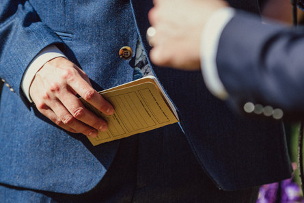 Small little yellow notebook containing wedding vows.