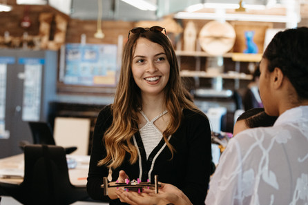 Student smiling inside Mount Holyoke's Fimbel Lab and Makerspace.