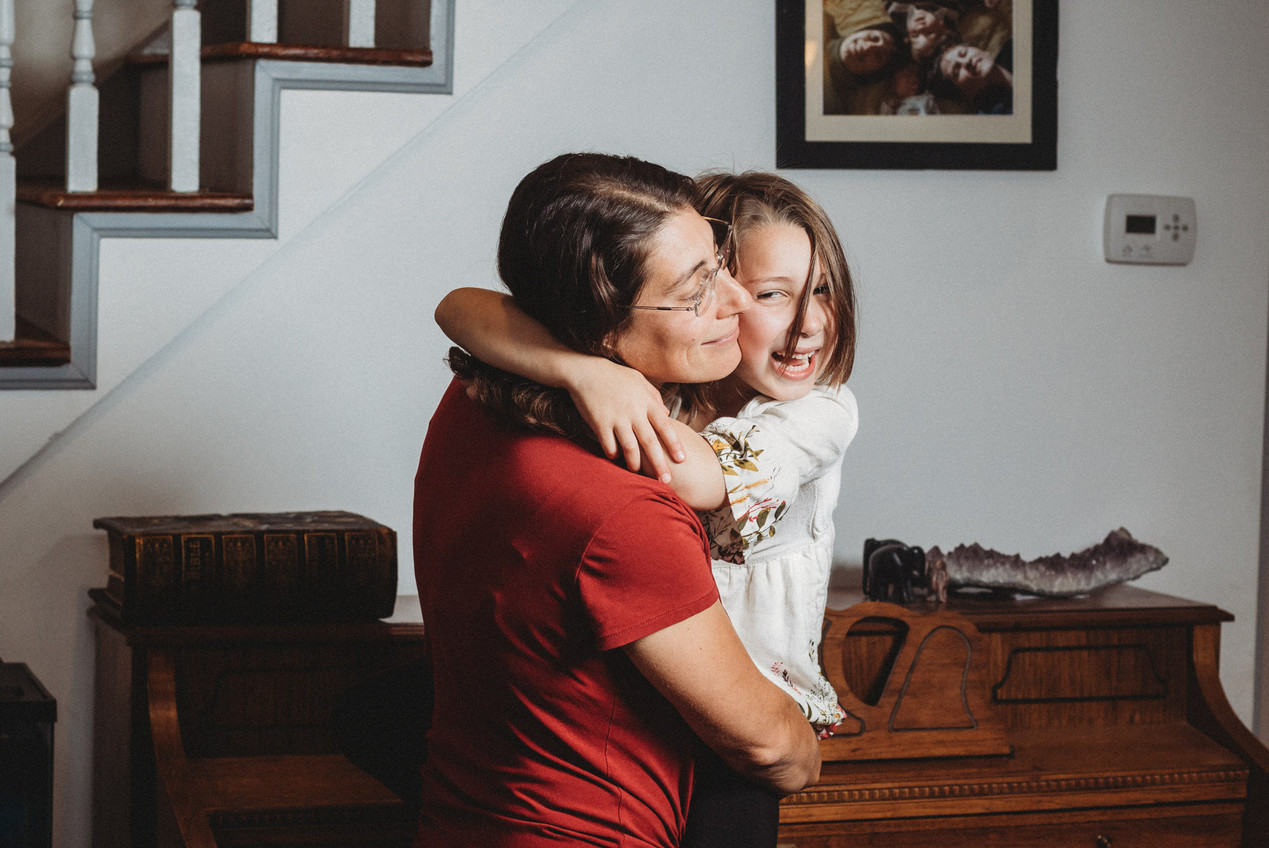 Dani holds her daughter tight and they laugh