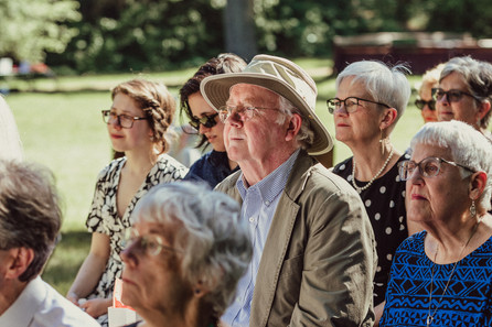 Family listens to vows.