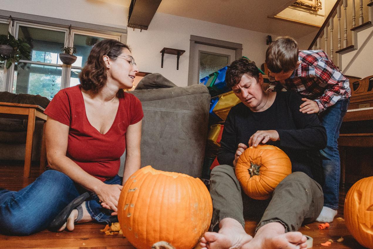 Family caves pumpkin