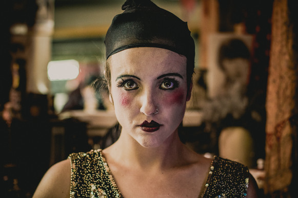 Emma of the band Old Flame, wearing white make up in a vaudeville look.