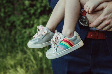 Child's small sparkly rainbow shoes.