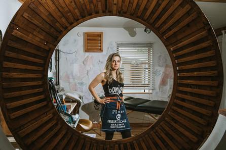 Tattoo artist Aubrey Mennella standing in her studio