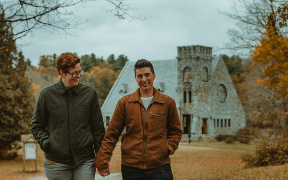 Emma and B walking away from West Boyston's old stone church on a fall day.