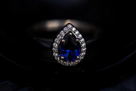 Blue stone tear drop engagment ring.