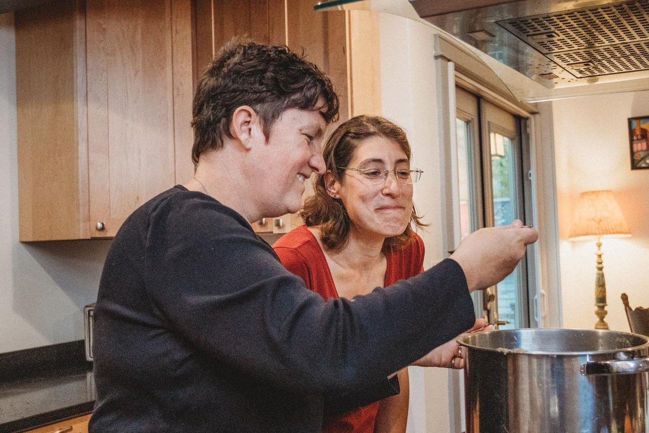 Lesbian couple tries homemade apple sauce.