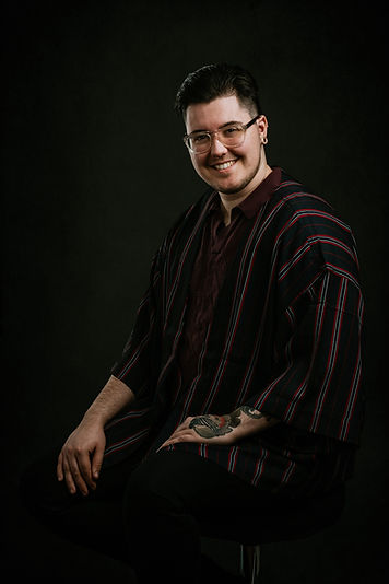 Sage Orville Shea In a flowy striped robe, glasses, and gold gauges. Photo taken by Brian Marsh Photography.jpg
