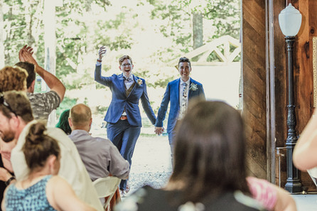 Couple enters the wedding venue at Camp Marshall.