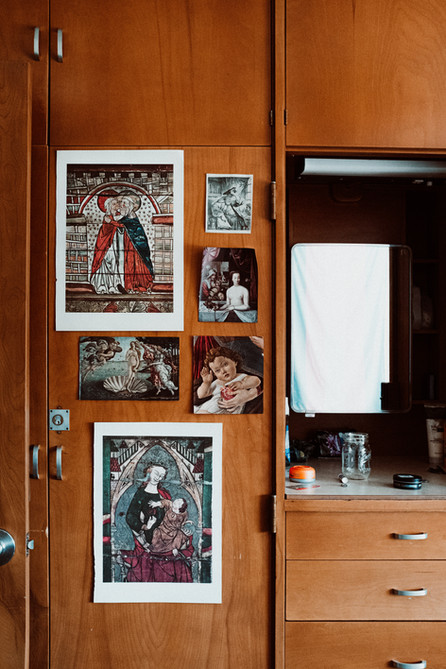 Decorated built in storage boasting mideval and renaissance art.