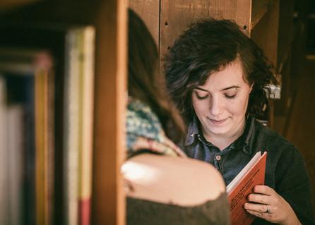 Author Avi Silver reading with their partner, fellow author, Sienna Triston.
