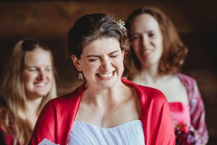 Bride, Sarah, laughs.
