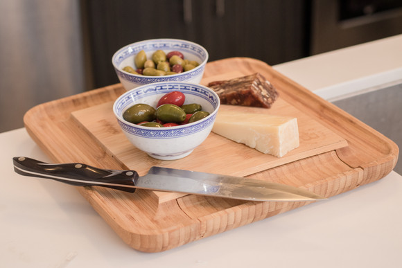 Cheese plate with olives.