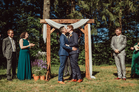 Queer wedding first kiss.