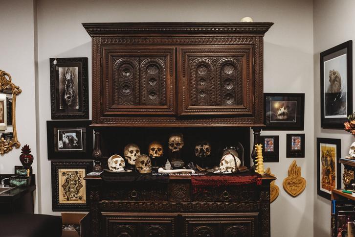 Ornate cabinet filled with skulls